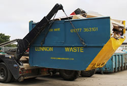 Skip Hire in Romford full skip being unloaded